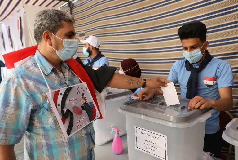 Some Syrians abroad already voted last week; in this May 20 photograph a Syrian in Lebanon, casts a ballot in Beirut. But Syrians who fled the country illegally -- and so who could not show an exit stamp in their passport -- were barred from voting