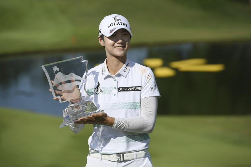 FILE - In this June 30, 2019, file photo, Sung Hyun Park holds up the trophy after winning the LPGA Walmart NW Arkansas Championship golf tournament in Rogers, Ark. Jin Young Ko and Sung Hyun Park were Nos. 1 and 2 in the women's world golf ranking when they left Florida on Nov. 24 after the LPGA Tour season finale. They skipped the opening two events in Florida and two others in Australia and planned to return to competition during the Asia swing. That's when the spread of COVID-19 halted sports. (AP Photo/Michael Woods, File)