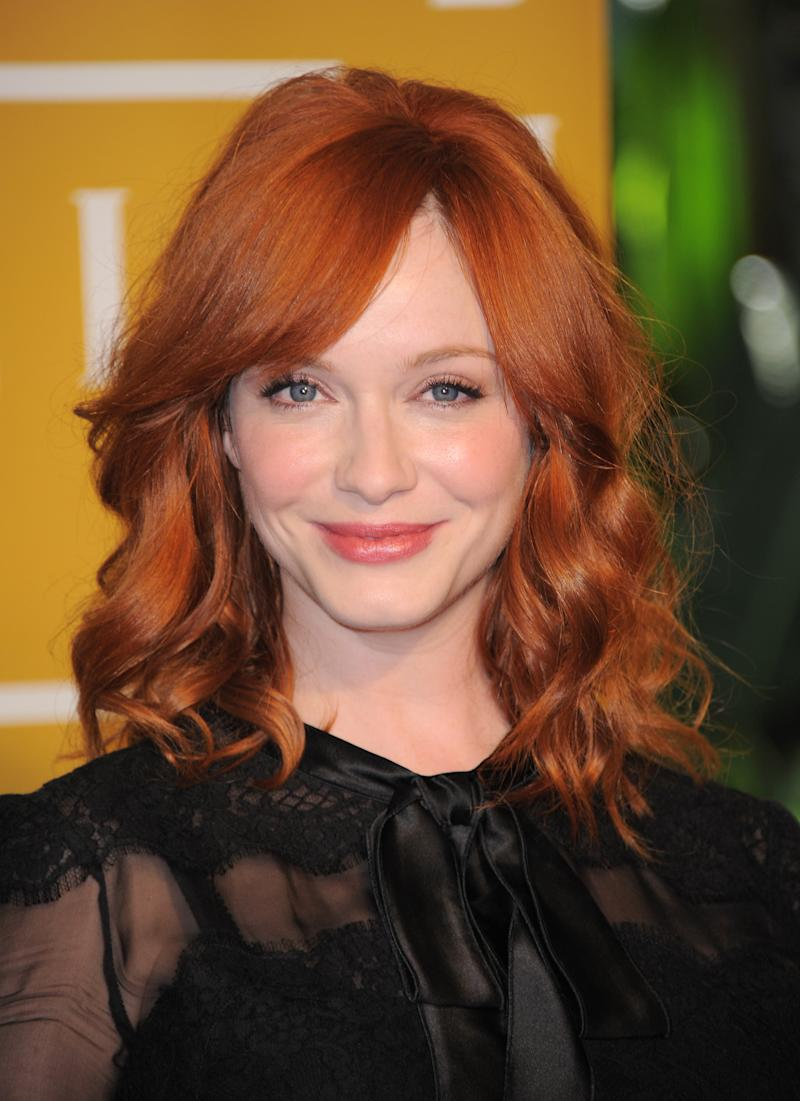 """FILE - In this Aug. 9, 2012 file photo, Christina Hendricks attends the Hollywood Foreign Press Association luncheon at the Beverly Hills Hotel in Beverly Hills, Calif. Hendricks, nominated for the third consecutive time for an Emmy for her supporting role in """"Mad Men,"""" said her all-time favorite TV shows were """"MASH"""" and """"Northern Exposure."""" (Photo by Jordan Strauss/Invision/AP, File)"""