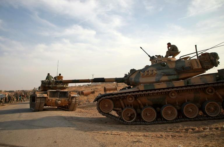 Turkish troops with American-made M60 tanks move near the village of Qirata in Syria (AFP Photo/Aaref WATAD)