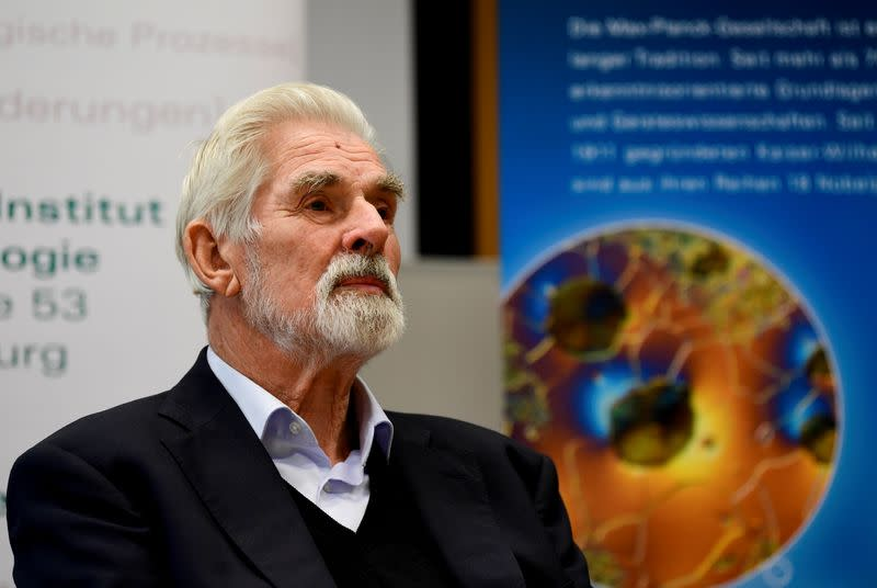 FILE PHOTO: German Klaus Hasselmann speaks to the media after winning the 2021 Nobel Prize in Physics