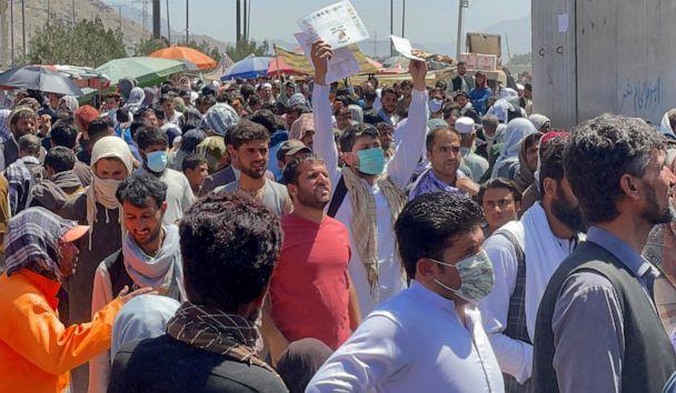 PHOTO: Crowds of people show their documents to U.S. troops outside the airport in Kabul, Afghanistan Aug. 26, 2021. (Reuters)