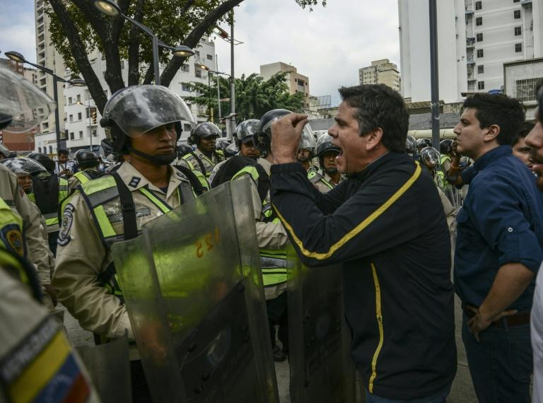 Venezuelan opposition deputy Rafael Guzman (C), confronts National Guard during a protest in front of the National Attorney's General office in Caracas