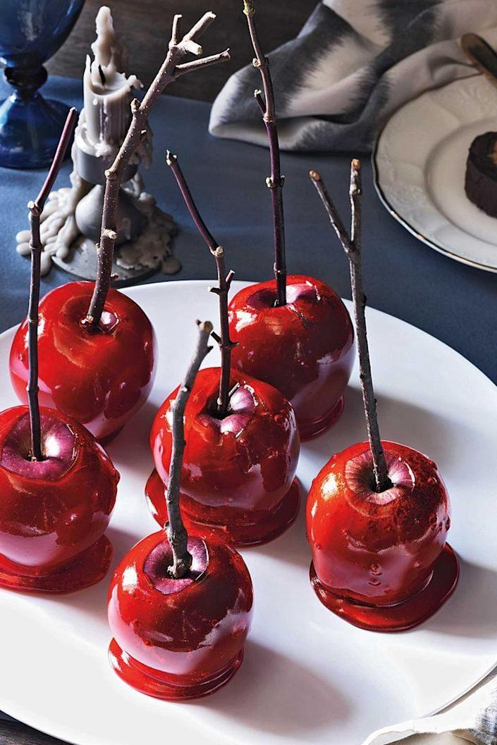 """<p>Create a bewitching version of this beloved candy-coated treat by dipping small Red Delicious apples in a bright red syrup flavored with red cinnamon candies.</p><p><a href=""""https://www.womansday.com/food-recipes/food-drinks/recipes/a11353/candy-apples-recipe-122751/"""" rel=""""nofollow noopener"""" target=""""_blank"""" data-ylk=""""slk:Get the Candy-Covered Apples recipe."""" class=""""link rapid-noclick-resp""""><strong><em>Get the Candy-Covered Apples recipe. </em></strong> </a> </p>"""