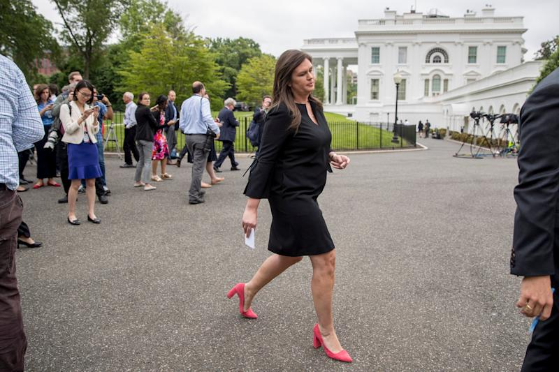 White House press secretary Sarah Huckabee Sanders departs after speaking to members of the media outside the West Wing of the White House, Wednesday, May 8, 2019, in Washington. (AP Photo/Andrew Harnik)