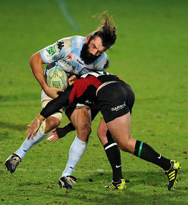 Racing's No. 8 Sebastien Chabal (L) gets tackled by Saracen's centre Brad Barritt (R) during the Heineken Cup rugby union match between Saracens and Racing Metro 92 at Vicarage Road in Watford on December 11, 2010. Racing Metro 92 won the game 24-21. AFP PHOTO / Adrian Dennis (Photo credit should read ADRIAN DENNIS/AFP/Getty Images)