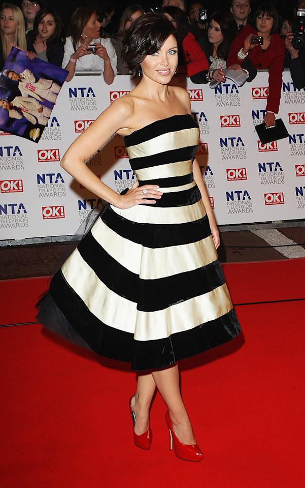 """Following in Cheryl's footsteps was fellow """"X Factor"""" fixture Dannii Minogue, who sported a chic strapless black-and-white striped cocktail frock and patent leather platform pumps to the star-studded soiree. Mike Marsland/<a href=""""http://www.wireimage.com"""" target=""""new"""">WireImage.com</a> - January 20, 2010"""