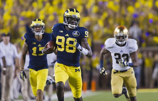 Michigan quarterback Devin Gardner (98) rushes on a break away run in the second quarter of an NCAA college football game with Notre Dame, in Ann Arbor, Mich., Saturday, Sept. 7, 2013. (AP Photo/Tony Ding)