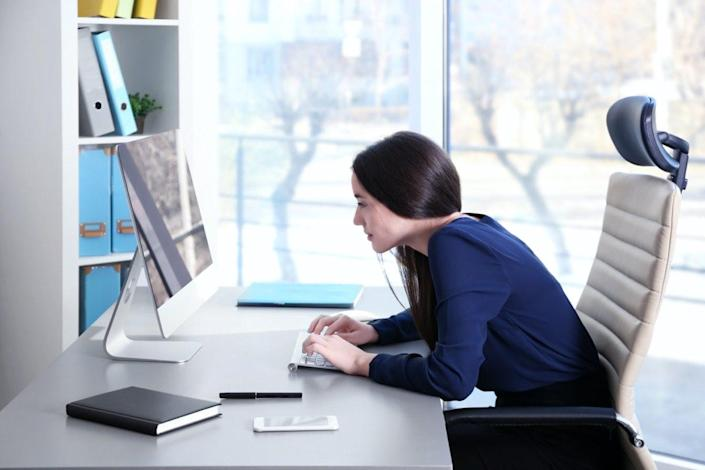 Young woman working with computer at office
