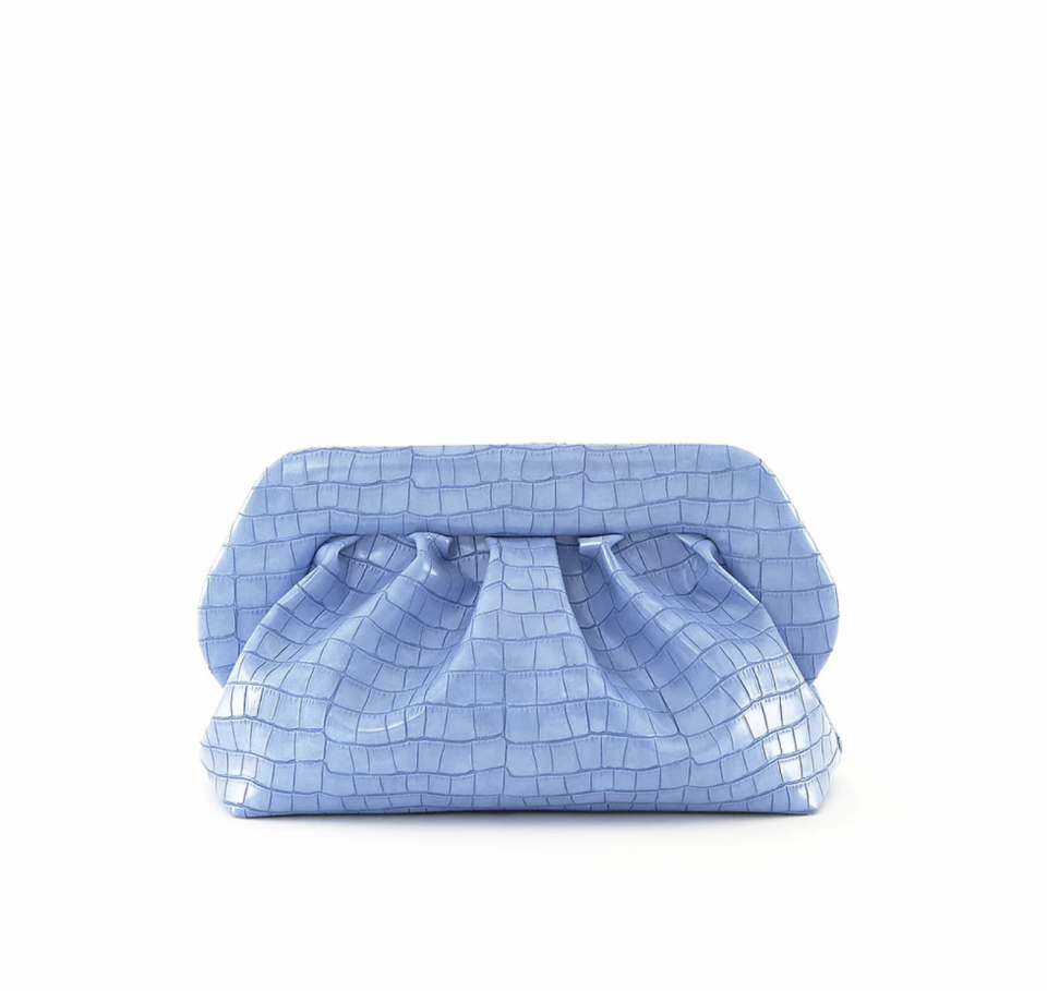 """<p><strong>The Moire</strong></p><p>the-moire.com</p><p><strong>$346.10</strong></p><p><a href=""""https://www.the-moire.com/product-page/bios-vegan-croco-periwinkle?currency=USD"""" rel=""""nofollow noopener"""" target=""""_blank"""" data-ylk=""""slk:SHOP NOW"""" class=""""link rapid-noclick-resp"""">SHOP NOW</a></p><p>An adorable, luxe, vegan bag is the perfect thing to get your friend, partner, or relative who loves to accessorize. They'll be wearing this pretty thing allllll summer.</p>"""