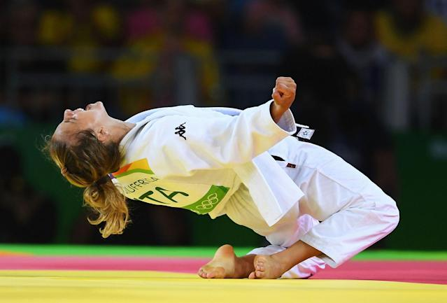 <p>Odette Giuffrida of Italy celebrates after defeating Yingnan Ma of China during the Women's -52kg semi final on Day 2 of the Rio 2016 Olympic Games at Carioca Arena 2 on August 7, 2016 in Rio de Janeiro, Brazil. (Photo by Laurence Griffiths/Getty Images) </p>