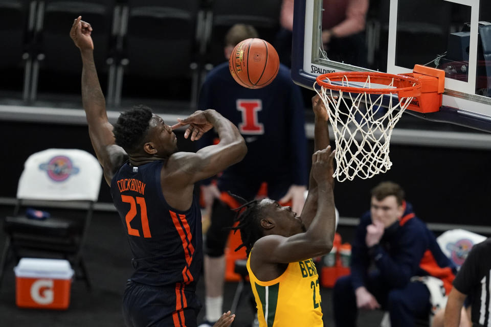 Baylor's Jonathan Tchamwa Tchatchoua (23) has his shot blocked by Illinois' Kofi Cockburn (21) during the first half of an NCAA college basketball game, Wednesday, Dec. 2, 2020, in Indianapolis. (AP Photo/Darron Cummings)
