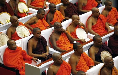 Buddhist monks listen as Pope Francis speaks during the Interreligious Encounter at the Bmich in Colombo January 13, 2015. REUTERS/ Stefano Rellandini