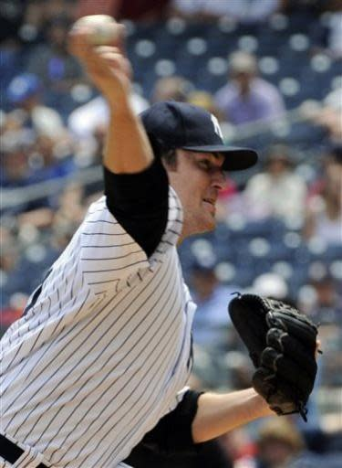 New York Yankees pitcher Phil Hughes throws against the Texas Rangers during the first inning of a baseball game Thursday, June 27, 2013, at Yankee Stadium in New York. (AP Photo/Bill Kostroun)