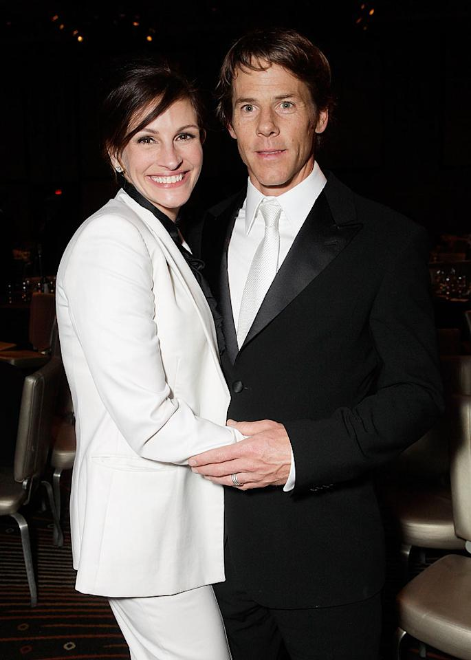 "Julia Roberts' long list of famous relationships includes Dylan McDermott, Kiefer Sutherland, Benjamin Bratt, and of course, country crooner Lyle Lovett, whom she married and divorced within two years. She finally stumbled into long-term love when she fell for cameraman Danny Moder while shooting ""The Mexican"" in 2000. Though Roberts was still dating Bratt at the time and Moder was actually married, the two dumped their significant others and tied the knot in July 2002. Nearly a decade later, the couple is still going strong and have three children together."