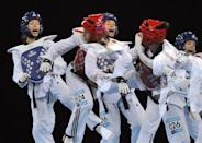 Lucija Zaninovic of Croatia (L, blue helmet) competes against Maieva Coutant of France during the Olympics 2012 Taekwondo test event at the ExCel centre in east London December 3, 2011. Picture taken using an in-camera multiple exposure technique.