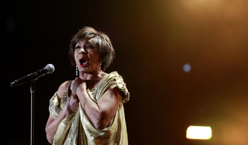 "Welsh singer Shirley Bassey performs on stage during ""Welcome to Wales,"" the Ryder Cup celebration concert at the Millennium Stadium in Cardiff, Wednesday, Sept. 29, 2010.  (AP Photo/Matt Dunham-Pool)"