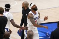 Los Angeles Clippers forward Marcus Morris Sr., center, walks to the bench after fouling out in the second half in Game 3 of an NBA basketball first-round playoff series against the Dallas Mavericks in Dallas, Friday, May 28, 2021. (AP Photo/Tony Gutierrez)