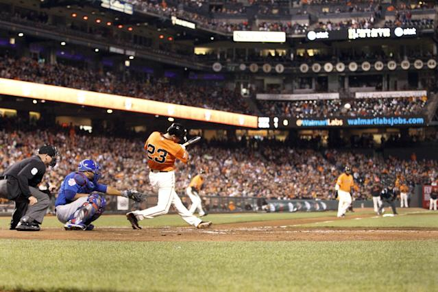 San Francisco Giants' Jeff Francoeur (23) hits a two run RBI against Chicago Cubs starting pitcher Edwin Jackson during the seventh inning of a baseball game on Friday, July 26, 2013, in San Francisco. (AP Photo/Tony Avelar)