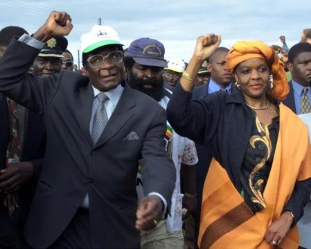 FILE PHOTO - Zimbabwe President Robert Mugabe arrives with his wife Grace for an election rally in Madziwa