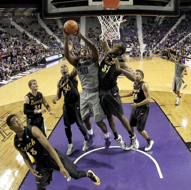 Kansas State's D.J. Johnson (50) puts up a shot during the second half of an NCAA college basketball game against Long Beach State, Sunday, Nov. 17, 2013, in Manhattan, Kan. Kansas State won 71-58. (AP Photo/Charlie Riedel)