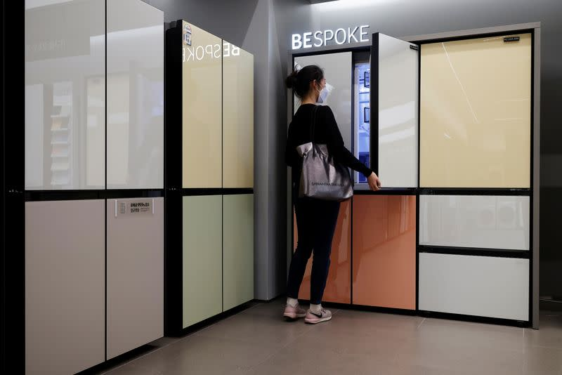 A woman looks around Samsung Electronics' BESPOKE refrigerators on display at its store in Seoul