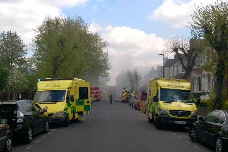 Fire: The leafy north London street has been engulfed in smoke (LAS)