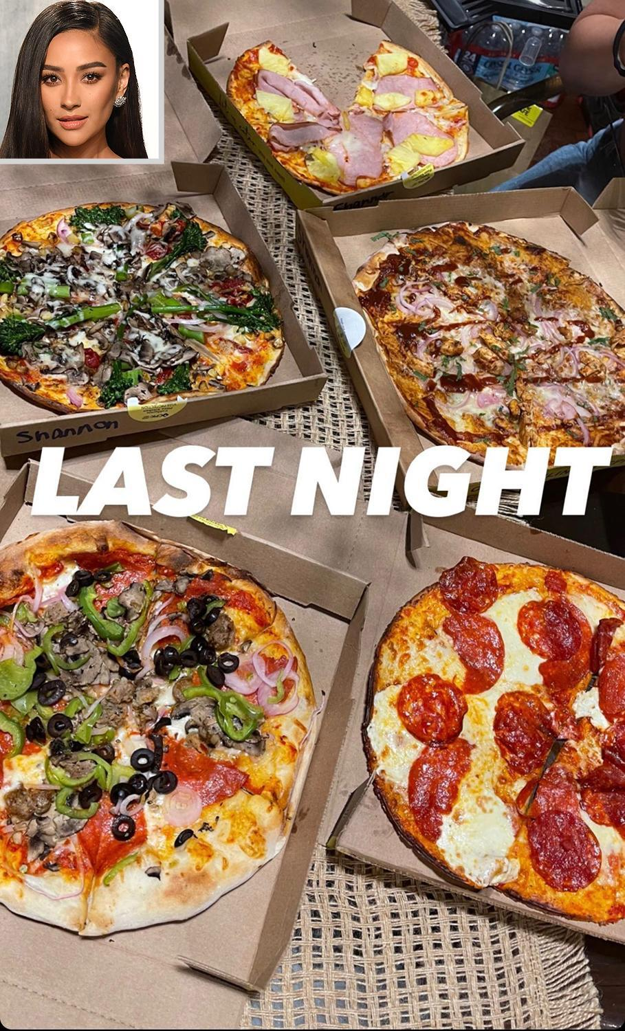 <p>Mitchell enjoyed a pizza feast with friends and we spy just about every topping you could dream of - Hawaiian-style, broccolini, peppers and olives, pepperoni, red onions and more. </p>