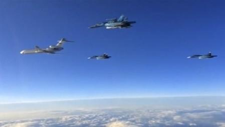 Russian military jets fly above an unidentified location after taking off from the country's air base in Hmeymin, Syria to head back to Russia, part of a partial withdrawal ordered by President Vladimir Putin, in this still image taken from video March 15, 2016. REUTERS/Russian Ministry of Defence via REUTERS TV