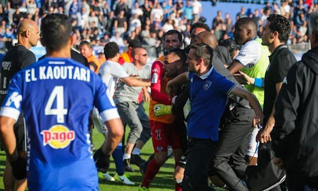 "<span class=""element-image__caption"">The Lyon goalkeeper Anthony Lopes is held back during an altercation with Bastia fans during the teams' subsequently abandoned Ligue 1 match.</span> <span class=""element-image__credit"">Photograph: Icon Sport/Icon Sport via Getty Images</span>"