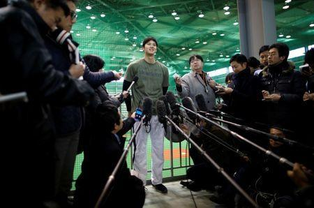 Japanese pitching and hitting star Shohei Ohtani speaks to media during his workout ahead of his move to the Los Angeles Angels in Kamagaya, east of Tokyo, Japan January 5, 2018. REUTERS/Issei Kato