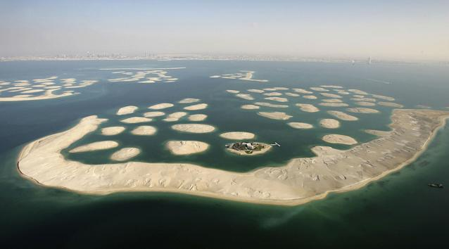 DUBAI, UNITED ARAB EMIRATES - DECEMBER 17: A view of new development, The World is seen from the air December 17, 2005 in Dubai, United Arab Emirates. The World consists of over 300 man made islands strategically positioned to form the shape of the world map, lying 4km off the coast of Dubai. The World will be the most exclusive and sought after community offering the most exciting residential and leisure opportunities in the fastest growing tourist destination on the planet. Almost two years of planning, research development and design went in to the construction. Measuring approximately 9 km in width by 7 km in length, the development will cover approximately 9,340,000 square meters, will be visible to the naked eye from space and will add an additional 232 kilometers of beachfront to Dubai's coastline. For The World to take shape, Nakheel is moving over 326 million cubic meters of sand to form the islands as well as building a 26 kilometer long oval shape breakwater. (Photo by Chris Jackson/Getty Images)