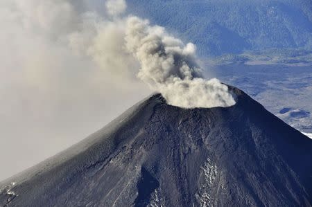 An aerial view shows smoke and ash rising from Villarrica Volcano, south of Santiago March 18, 2015.  REUTERS/Stringer