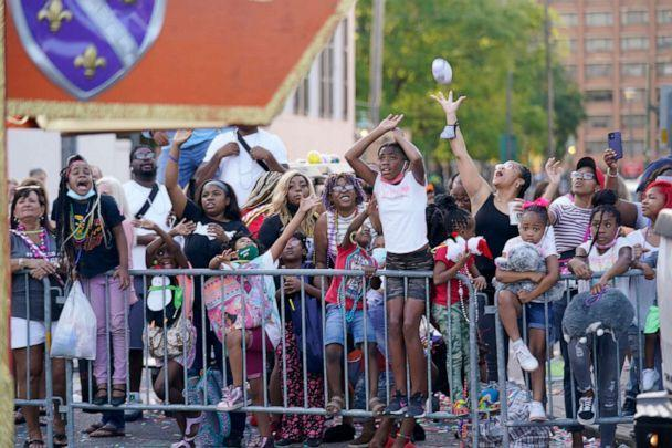 PHOTO: A crowd attends the 'Tardy Gras' parade in Mobile, Ala., May 21, 2021. (Gerald Herbert/AP, FILE)