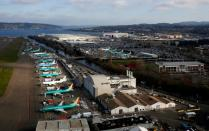 FILE PHOTO: An aerial photo shows Boeing airplanes, many 737 MAXs, parked on the tarmac at the Boeing Factory in Renton
