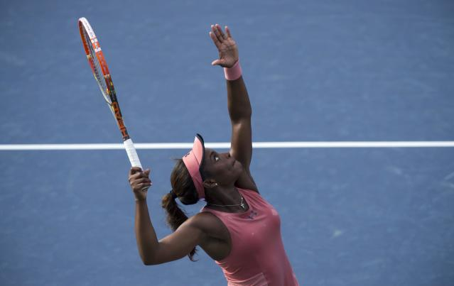 Sloane Stephens of the United States serves to Jelena Jankovic of Serbia at the Rogers Cup tennis tournament Wednesday Aug. 6, 2014 in Montreal. (AP Photo/The Canadian Press, Paul Chiasson)