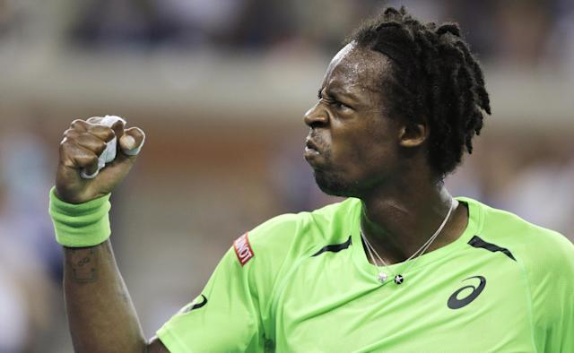 Gael Monfils, of France, pumps his fist after winning a point against Roger Federer, of Switzerland, during the quarterfinals of the U.S. Open tennis tournament, Thursday, Sept. 4, 2014, in New York. (AP Photo/Charles Krupa)
