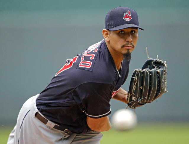 FILE - In this Sept. 30, 2018, file photo, Cleveland Indians starting pitcher Carlos Carrasco throws during the first inning of a baseball game against the Kansas City Royals in Kansas City, Mo. The Indians have signed Carrasco to a new, four-year contract through the 2022 season. Carrascos deal includes a club option for 2023. Financial terms of the contract were not immediately available. (AP Photo/Charlie Riedel, File)