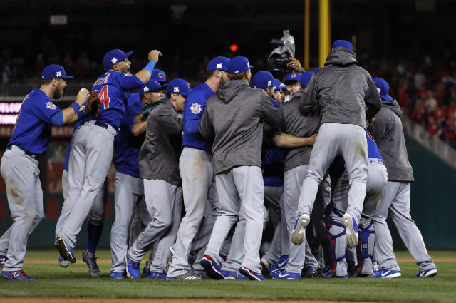 The Cubs celebrate after beating the Nationals 9-8 to advance to the National League Championship Series. (AP)