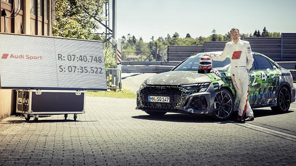 Frank Stippler with the Audi RS3 after his record-breaking lap. - Credit: Audi