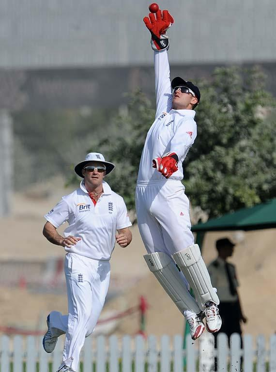England XI wicketkeeper Steven Davies (R) attempts to field a ball as captain Andrew Strauss (L) look on during the opening day of a three-day practice match between the England XI and ICC Combined Associate and Affiliate XI at The ICC Global Cricket Academy in Dubai Sports City on January 7, 2012. England plays three Tests, four one-day internationals and three Twenty20s against Pakistan in the United Arab Emirates between January 17 and February 27.