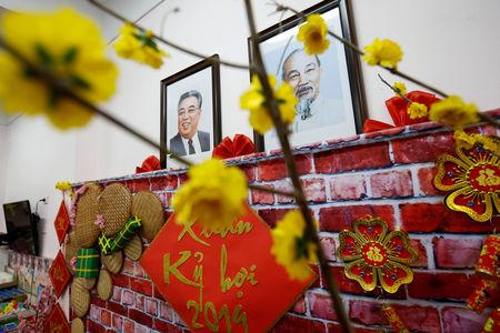 Portraits of late leaders North Korea's leader Kim Il and Vietnamese Ho Chi Minh hangs in a wall at the Vietnam-North Korea Friendship kindergarten, founded by North Korean Government in Hanoi, Vietnam February 13, 2019. Picture taken February 13, 2019. REUTERS/Kham