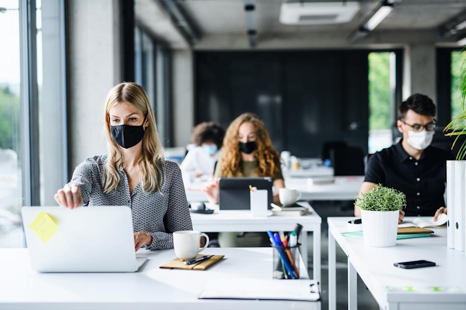 Employees returning to the office may have to wear masks. Image: Getty