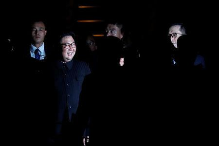 North Korea's leader Kim Jong Un is surrounded by guards as he visits Merlion Park in Singapore, June 11, 2018. REUTERS/Tyrone Siu