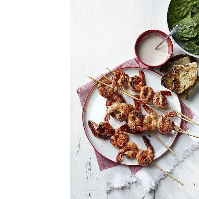 """<p>Drizzle a mayonnaise-based """"white sauce"""" on grilled shrimp to add even more oomph to this zesty dish.</p><p><em><a href=""""https://www.womansday.com/food-recipes/recipes/a50536/alabama-white-bbq-shrimp-recipe-wdy0615/"""" rel=""""nofollow noopener"""" target=""""_blank"""" data-ylk=""""slk:Get the Alabama White BBQ Shrimp recipe."""" class=""""link rapid-noclick-resp"""">Get the Alabama White BBQ Shrimp recipe.</a> </em></p>"""