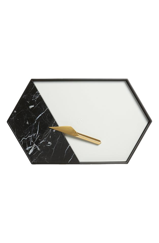 "<p>Make a statement with this gorgeous <product href=""https://www.nordstrom.com/s/rabbit-modular-serving-tray-cheese-knife-set/5624249?origin=keywordsearch-personalizedsort&amp;breadcrumb=Home%2FAll%20Results&amp;color=multi"" target=""_blank"" class=""ga-track"" data-ga-category=""Related"" data-ga-label=""https://www.nordstrom.com/s/rabbit-modular-serving-tray-cheese-knife-set/5624249?origin=keywordsearch-personalizedsort&amp;breadcrumb=Home%2FAll%20Results&amp;color=multi"" data-ga-action=""In-Line Links"">Rabbit Modular Serving Tray &amp; Cheese Knife Set</product> ($100, originally $125).</p>"