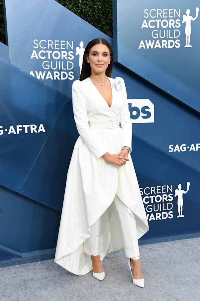 "<p>Wearing a custom-made <a href=""https://www.popsugar.com/fashion/millie-bobby-brown-louis-vuitton-dress-sag-awards-2020-47123272"" class=""ga-track"" data-ga-category=""Related"" data-ga-label=""https://www.popsugar.com/fashion/millie-bobby-brown-louis-vuitton-dress-sag-awards-2020-47123272"" data-ga-action=""In-Line Links"">Louis Vuitton outfit</a> consisting of tailored trousers and a high-low belted dress jacket featuring a modern boutonnière, Millie Bobby Brown redefined elegance at the SAG Awards.</p>"