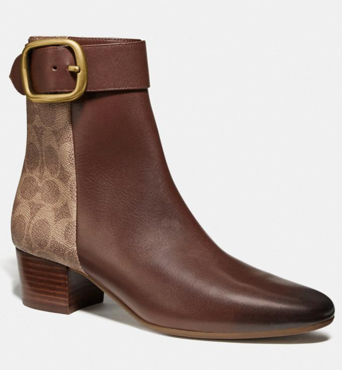 You can never go wrong with a pair of classic saddle booties. (Photo: Coach)