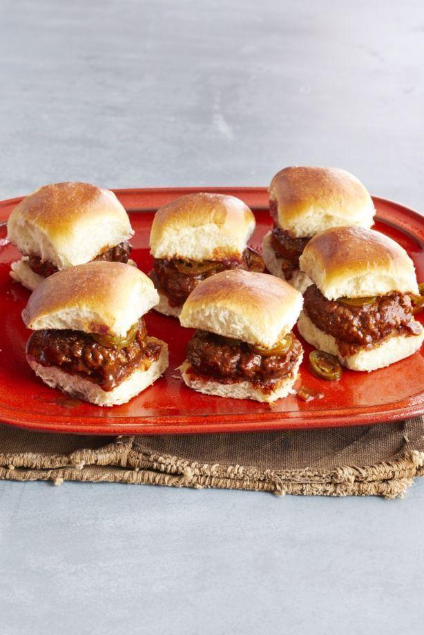 """<p>Serve these delightfully drippy beef sliders with a side of crispy French fries and coleslaw.</p><p><strong><a href=""""https://www.thepioneerwoman.com/food-cooking/recipes/a32335826/spicy-whiskey-bbq-sliders-recipe/"""" rel=""""nofollow noopener"""" target=""""_blank"""" data-ylk=""""slk:Get the recipe."""" class=""""link rapid-noclick-resp"""">Get the recipe.</a></strong> </p>"""