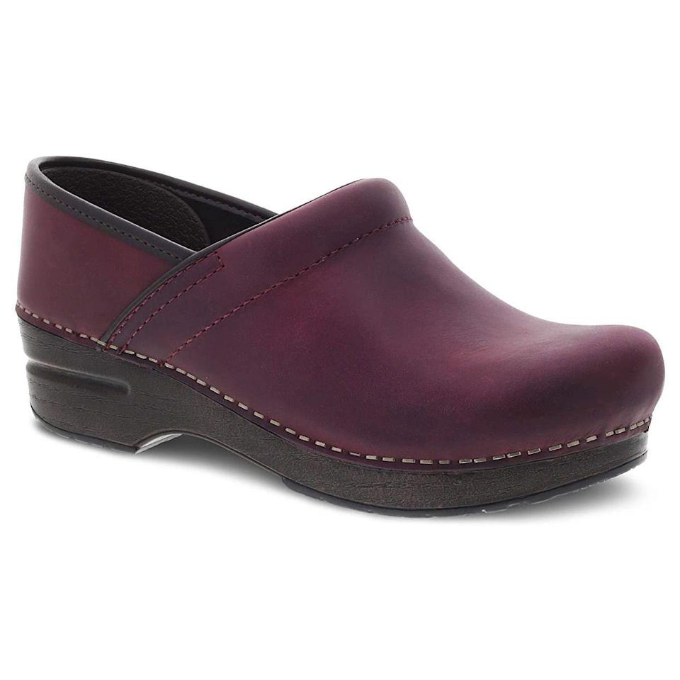 """<p><strong>Dansko</strong></p><p>amazon.com</p><p><strong>139.95</strong></p><p><a href=""""https://www.amazon.com/dp/B07856YDZY?tag=syn-yahoo-20&ascsubtag=%5Bartid%7C10055.g.33264582%5Bsrc%7Cyahoo-us"""" rel=""""nofollow noopener"""" target=""""_blank"""" data-ylk=""""slk:Shop Now"""" class=""""link rapid-noclick-resp"""">Shop Now</a></p><p>Nurses everywhere agree that these clogs are a must buy when standing on your feet all day seeing patients, according to 5,000 rave Amazon reviews. Although a bit pricey, these clogs are designed to last as they're made with 100% leather. Reviewers love that they're easy to wipe down at the end of the work day. Available in <strong>over 100 (!!!) colors</strong>, you're going to want one in every color! </p>"""